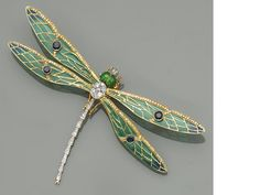 An enamel, diamond, sapphire and eighteen karat gold dragonfly brooch