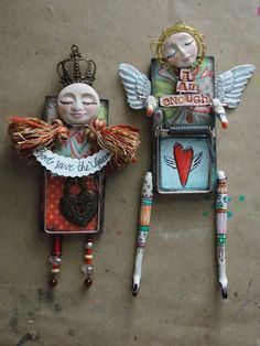 Mouse traps altered into art dolls.