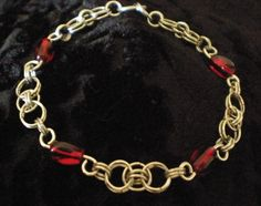 "This bracelet is beautiful and strong it has many ""s"" loops that are tightly held together by 4mm rings. Very shiny single tone piece. This is semi- heavy weight chainmaille for the wrist. This dec..."