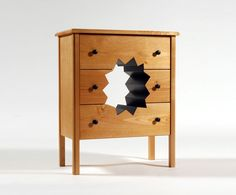 Oops! Cabinet    http://www.demilked.com/weird-and-wacky-furniture-by-straight-line-designs/