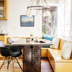 "Go ""modern organic"" with textural furnishings like the rough-hewn table and blown-glass and iron chandelier."