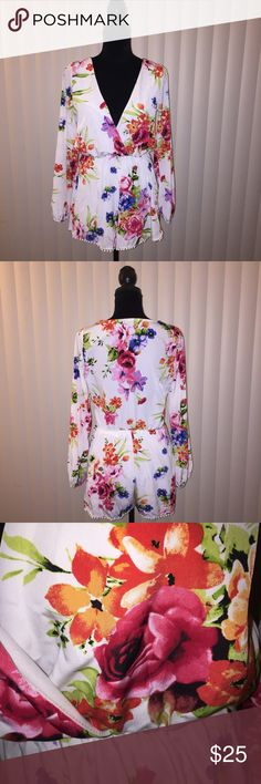 Floral Romper Size S This floral Romper is so posh and cute. The material is 100% polyester. WINDSOR Other