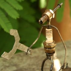 Fair Trade Spark Plug Sculpture — Handmade in Burkina Faso — from Fair & Square Imports — Artisans in Ougadougou, Burkina Faso, turn recycled spark plugs into fun sculptures. Makes a great guy's gift! Comes in Guitarist, Handyman, Putting Golfer, Swinging Golfer, Basketballer, and Lifter.