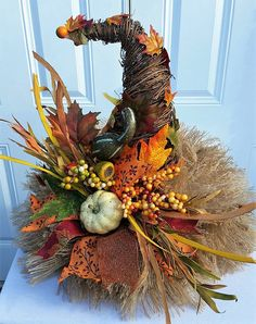 This cute Scarecrow Hat Centerpiece will be a favorite addition to your Fall Decor. The Rustic Centerpiece was made using a grapevine cone that was manipulated to form a curve as if the tip is flopping over. The base or brim of the hat was created using a frayed poly burlap mesh.
