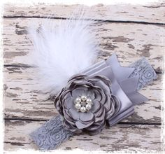 I love these delicate feathered pearl, Satin, and rhinestones laced headbands. One size fits anyone....babies on up.