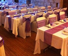 Using Colored Tulle Table Runners Is A Cheap Way To Add Your Wedding Colors