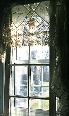 lovely lace valance.....this i could manage....i wouldn't have to cut into them.....