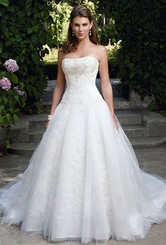 Brides: Casablanca Bridal. Lace appliqu�s sewn onto netting over Silky Satin, gathered drop waist ball gown is accented with hand sewn beads on the bodice.