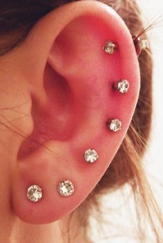 I've got several piercings in both ears. Not as many as this woman has in the photo but currently 3 piercings in each ear. Piercing Tattoo, Body Piercings, Full Ear Piercings, Piercing Chart, Beads Jewelry, Jewlery, Copper Jewelry, Dangle Belly Rings, Bodies