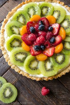 How to make homemade fresh fruit tart with buttery pastry crust and mascarpone cream filling! Recipe and step pictures on sallysbakingaddiction.com