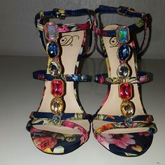 strappy high heel Multicolored gem and floral print strappy heel. Approx 4 inch. Never worn Shoes Heels