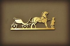 Gold Hermès Caleche- design created in 1961 by Guy Robert