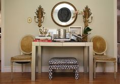 Two pretty chairs, console table, ottoman - and balanced decor.  Corina's Hollywood Glamour on a Budget