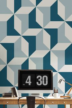 Looking for contemporary wallpaper designs for your home? This blue geometric wallpaper oozes cool and sophistication. It works a dream in home office spaces adding colour without being overwhelming.