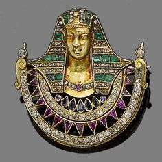 A sapphire, ruby, emerald and diamond pendant/brooch, circa 1870 In the Egyptian revival style, designed as the bust of a pharoah .