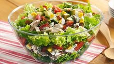 Easily assemble a zesty oil-and-vinegar dressing to tastefully coat a main-dish salad showcasing lettuce and chicken.