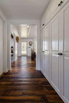 Traditional Entryway with Standard height, Built in cabinets, French doors, can lights, Paint, Hardwood floors