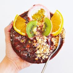 Pretty amazing maqui bowl for lunch today. Made this simply using frozen mango, ½ a frozen banana, frozen blueberries, maqui powder and water. Topped with passionfruit, kiwi fruit, orange, shredded coconut and fruit fee muesli. #maqui #health #food #fruit #acai #cleaneating #lifestyle #foodblog