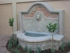 French inspired water feature   by Garden Bleu