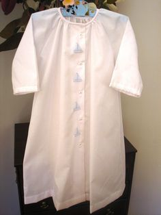 This precious baby boy's day gown is made of soft white Imperial Batiste. This day gown opens in the front and features a front placket with