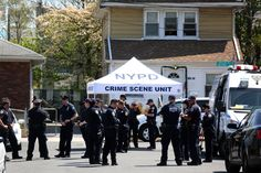Crime scene investigators set up a tent outside a home on 212th Place in Queens Village, where Demet... - Chang W. Lee/The New York Times