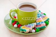Coffee on a green cup with cookies and candies in a full length image. Download the photo without watermark @ www.kozzi.com or you can click the image.