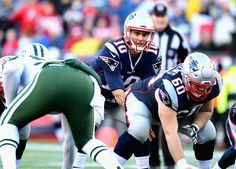 Jimmy Garoppolo Photos Photos - Jimmy Garoppolo #10 of the New England Patriots prepares to take a snap during the fourth quarter of a game against the New York Jets at Gillette Stadium on December 24, 2016 in Foxboro, Massachusetts. - New York Jets v New England Patriots