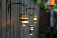 A Glowing Gathering: DIY Outdoor Hanging Mason Jar Lights --By Tim and Mary Vidra on Jul 17, 2014