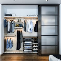 Salty Lime Veneer gives an artistic yet sophisticated style to this contemporary reach-in closet. With floating shelves, LED (hanging) U-shaped rods, pullout bins and shoe storage, this custom reach-in closet provides the perfect blend of form and function. #ClosetFactory