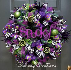 Halloween Wreath, Halloween Door Decor, Deco Mesh Wreath, Halloween Wreath for Front Door, Halloween Decor  Spooky, Whimsical and Fun !!!  This not so scary Halloween wreath is constructed on a wire wreath form using many layers of premium deco mesh in a metallic black/lime/purple check, metallic black, metallic purple and metallic lime green. Deep purple feathers and silver glitter spiders on wire gives ghostly movement to this wreath. Four different patterns of wire ribbon surroun...