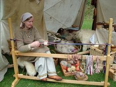 Mary Goss from the Mogh Roith Living History Society weaving on an Oseberg style tablet-weaving loom
