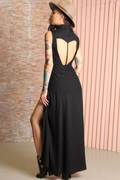 Black maxi dress by Somedays Lovin featuring black on black embroidery on the mid-section, full length and the right amount of elegance and playfulness. The high-cut, button-up front is perfectly balanced with large cut-outs on the back and thigh-skimming splits.
