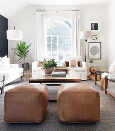 modern farmhouse living room design, modern farmhouse family room decor with white walls, modern sofa and neutral throw pillows and neutral area rug, neutral living room design and leather poufs My Living Room, Interior Design Living Room, Home And Living, Living Room Designs, Living Spaces, Living Room Seating, Living Room Ottoman Ideas, Modern Living Room Furniture, Gray Couch Living Room