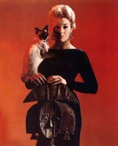 way before Bewitched, Kim Novack played the hottest witch ever in Bell, Book, and Candle. Here she is with her cat, Pyewacket :)