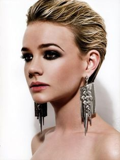 Wet hair, the summer's hottest hairstyle, isn't just for the day time. Dress it up with smoky eyes and statement jewelry