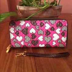 """Vegan Leather Clutch w/ Hearts Pink vegan leather with black and white graphic hearts design. Wrist strap included. Two zipper pockets, three bill slots, and two card slots. Approximately 7.5""""L v 4.5""""H.   If you have questions, please ask. Bags Clutches & Wristlets"""