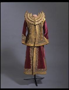 Court robe, Burma,  ca. 1878-1885.  This ceremonial military costume of gold encrusted green and plum velvet was specially styled for a minister who served King Thibaw (r. 1878-1885).