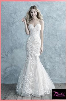 de0d3a4a090 We love the ruching that covers this bridal gown! The lace on this wedding  dress