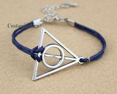 Deathly Hallows bracelet  antique silvercharm by CustomizeEra, $1.66 -- Bought.