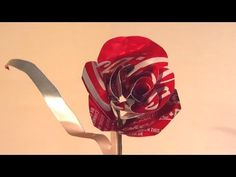 This video shows a step-by-step guide for making a Valentine's Day rose out of an empty Coke can (or soda of your choice). All you need is an empty Coca-Cola can (or other soda can), a knife, and a pair of scissors. Video: . Follow the instructions in the YouTube video above and you could end up with this: Share your results below.