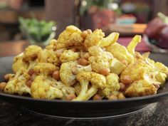 Roasted Cauliflower and Chickpeas. Usually eyeball the spicing and use much more tumeric and cumen than is called forl