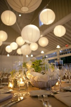 classic white & green wedding centerpieces + glowing white paper lanterns for wedding reception