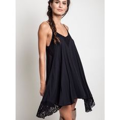"""""""The Slip"""" Lace Babydoll Tunic/Dress Can be worn as a dress or a tunic. Double layer so it is not see through. Lace embellishments make it the perfect little black dress. Brand new WITHOUT tags. Also available in IVORY. Bare Anthology Dresses"""