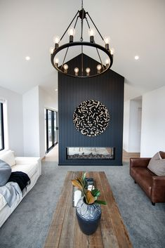 This chandelier creates a warm and welcoming statement in the Riverhead Show Home living space. #showhome #lightening #chandelier #livingroom #lounge #riverheadshowhome #coatesvilleplan #generationhomesnz Living Spaces, Living Room, Contemporary Chandelier, Family Rooms, Home And Living, Lounge, Ceiling Lights, Warm, Home Decor