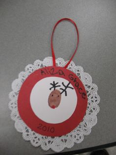 Simple yet cute thumbprint Christmas Reindeer ornament using a doily and ribbon. Preschool Christmas, Christmas Activities, Christmas Crafts For Kids, Diy Christmas Gifts, Winter Christmas, Kids Christmas, Holiday Crafts, Holiday Fun, Christmas Ornaments