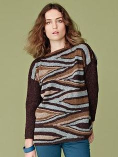 Mary - Knit this womens 70's graphic sweater from Rowan Knitting & Crochet Magazine 54, a design by Julia Frank using the wonderfully tweedy yarn Felted Tweed (wool, alpaca and viscose). With abstract print detail to the body and plain sleeves, this knitting pattern is suitable for the experienced knitter.