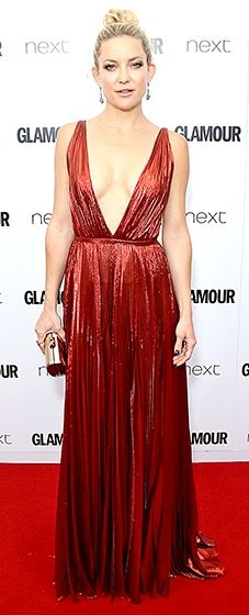 Kate Hudson took the plunge in a metallic red J. Mendel gown with a deep V-neckline, teamed with a Jimmy Choo clutch and golden jewels.