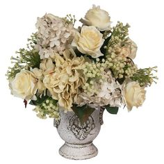 Faux lilac and rose arrangement with baby's breath accents in a white footed urn.  Product: Faux floral arrangementC...