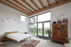The spacious master bedroom suite has doors that open onto decking in the garden, making the most of the view