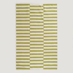 Our exclusive Green and White Stripe Cotton Dhurrie Rug is expertly handwoven in India of soft 100% cotton in the style of traditional dhurrie rugs. Update the look of any room for the perfect price with the casual beauty of this unique rug.